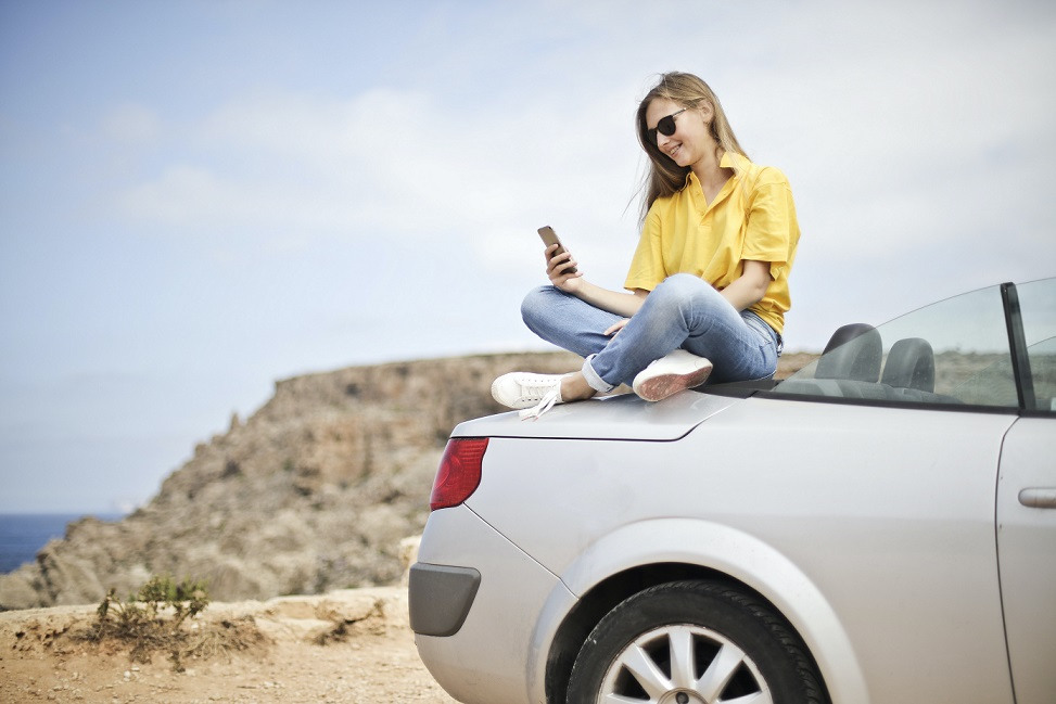 College Student Sitting on Back of Convertible